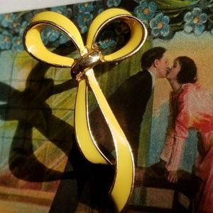 Vintage yellow enamel ribbon pin gold tone